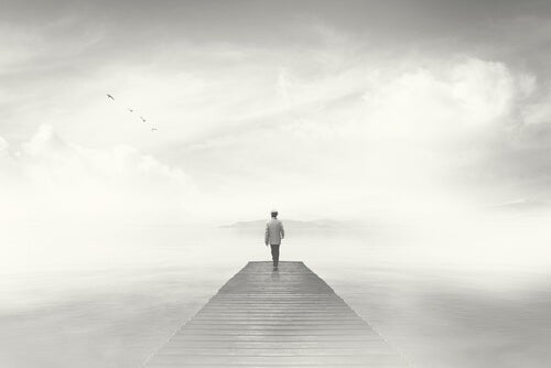 A man walking in the fog.