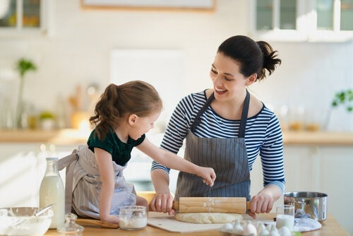 A mother and daughter in the kitchen.