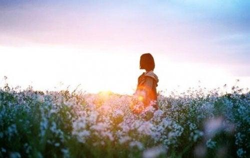 A woman in a flower field.