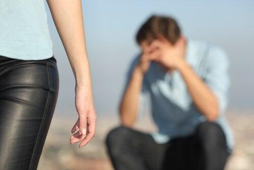 A woman walking away from a man.