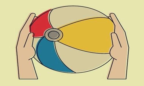 Hands holding a beach ball.