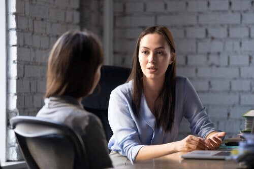 A woman interviewing someone.