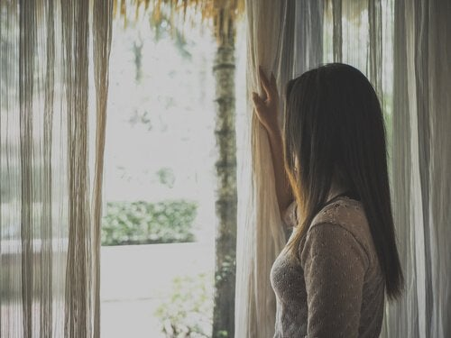 A woman by a window.