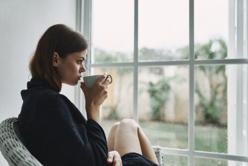 A woman in front of a window.