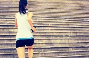 A woman running up steps.