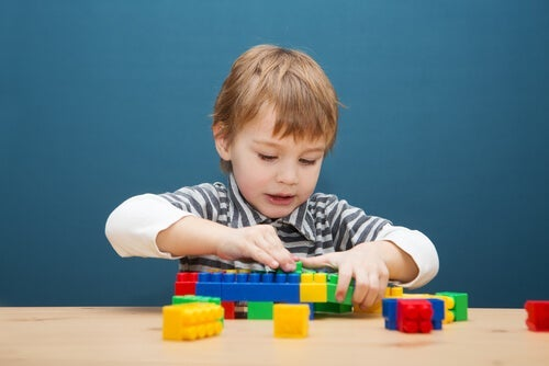 A child with some lego bricks.