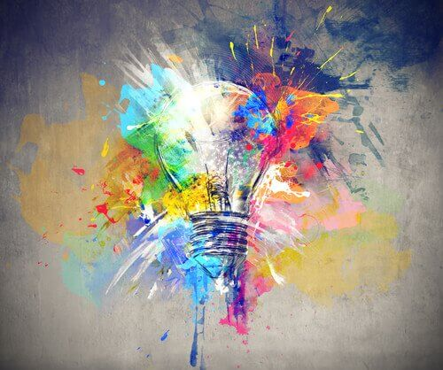 A lightbulb surrounded by colors, representing an impulse of creativity after undergoing brain stimulation.