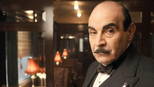 An image of Hercules Poirot in a suit.