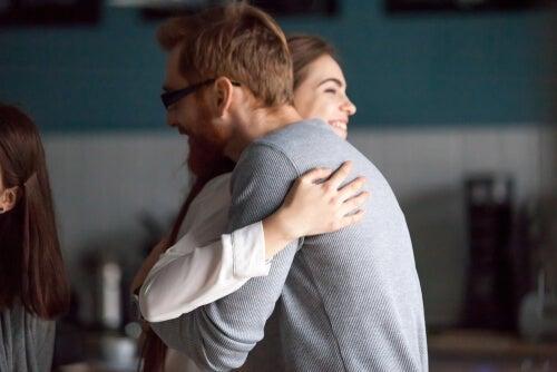 Two people hugging.