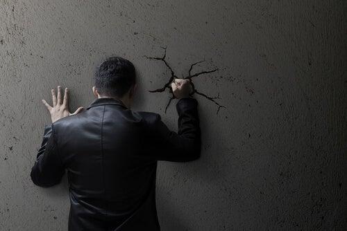 A man hitting a wall.