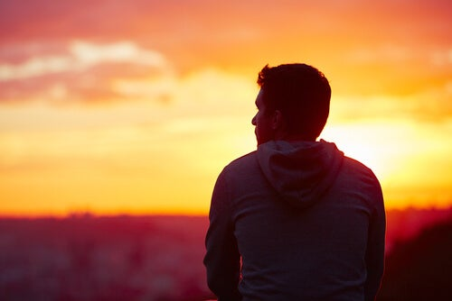 A man looking at a sunset.
