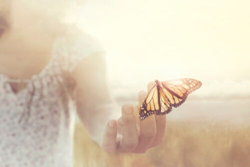 A woman with a butterfly.