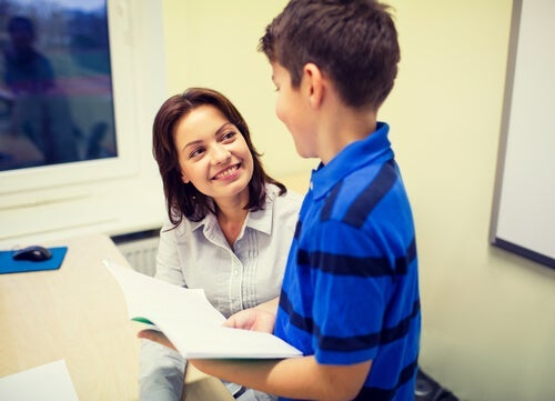 A teacher smiling at her student.