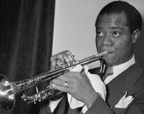 Louis Armstrong playing an instrument.