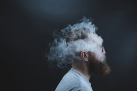 A guy with his head in smoke.