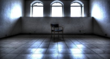 A single chair in an empty room.