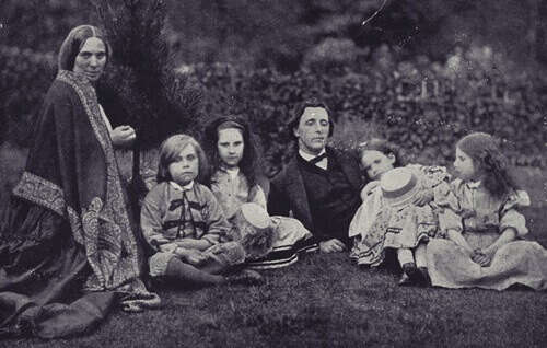 Lewis Caroll surrounded by the Lydell girls.