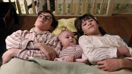 The Baudelaire children sleeping on the floor.