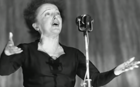 Édith Piaf performing on stage.