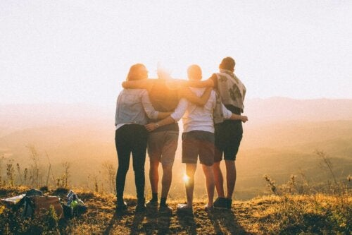 Four friends watching the sunrise.