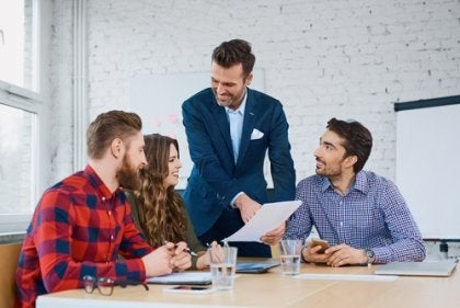 Four people at a business meeting.