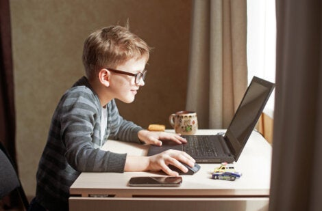 A kid playing on a laptop in a world of digitization.