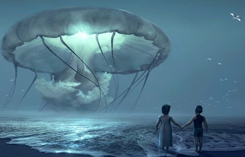 Two kids before a giant jellyfish.