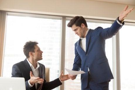Two men arguing at work.