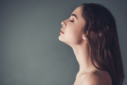 A woman practicing diaphragmatic breathing.