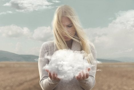 A woman holding a cloud in her hands.