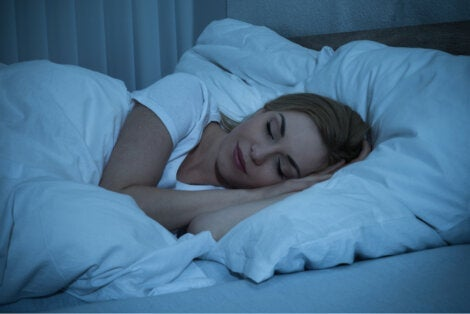 A woman sleeping at night.