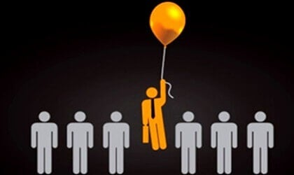 A man floating on a balloon.