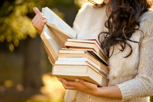 A woman with some books.