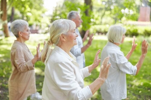 A group of seniors practicing Qi Gong.