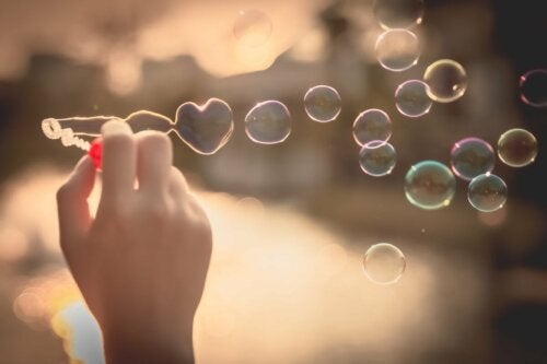 A person blowing bubbles.