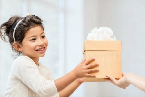 A girl receiving a present.