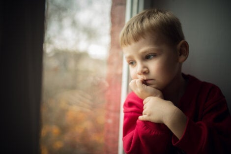 A little boy looking out the window.