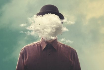 A man with his head obscured by clouds.