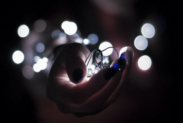 A hand holding a light.