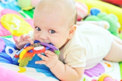 A baby playing working on sensory development.