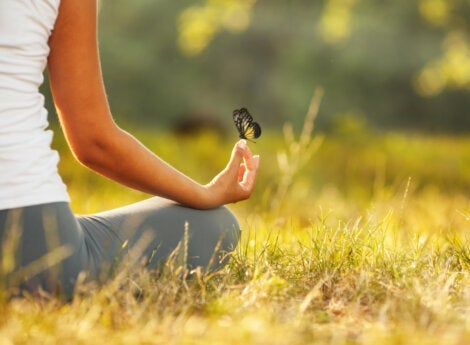 A woman meditating who isn't frightened by silence.