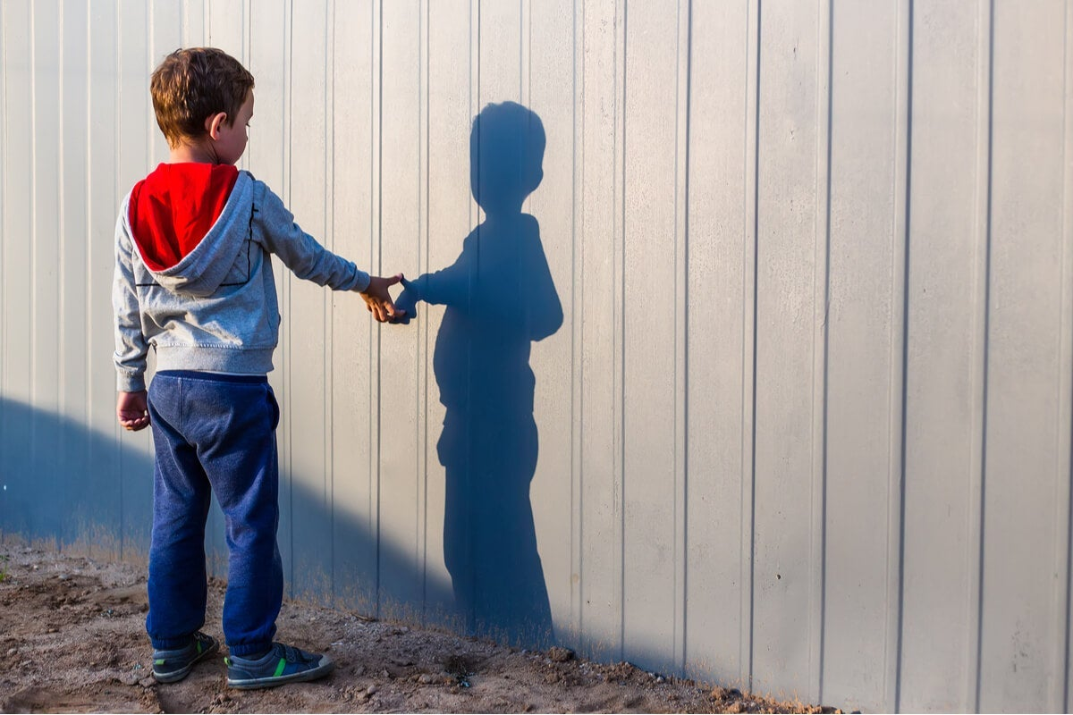 A boy with his shadow.