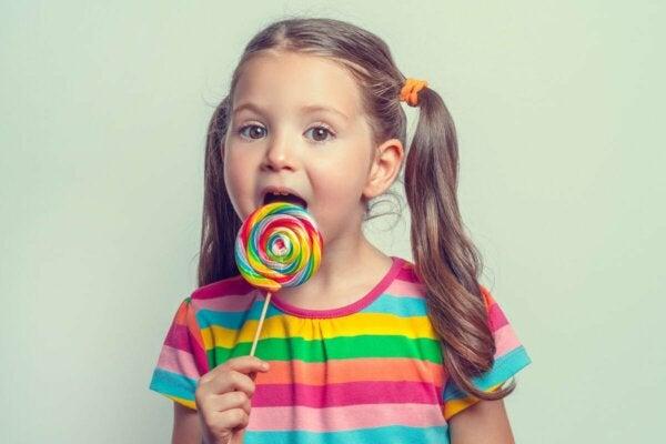 A girl with a lollipop.