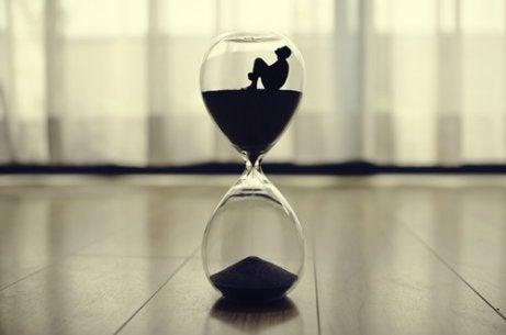A man sitting inside an hourglass.