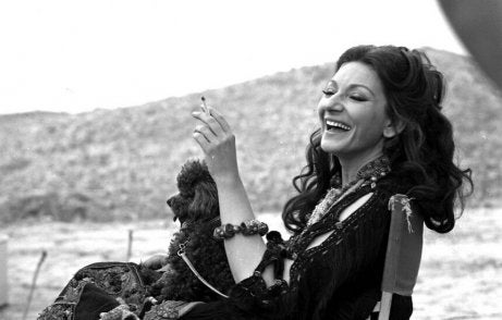 A photo of Maria Callas laughing.