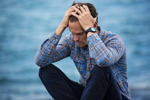 A worried man sitting.