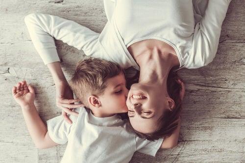 A boy kissing a woman.