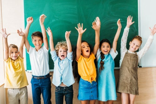 A group of children cheering.