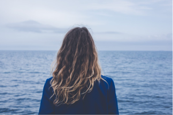 A woman looking out to sea.