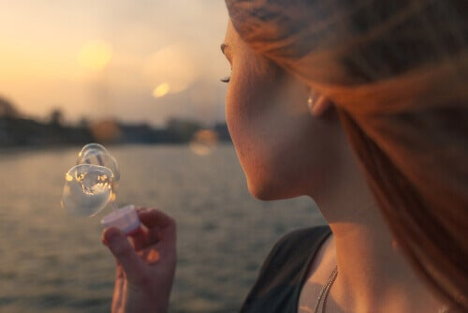 A woman blowing bubbles.